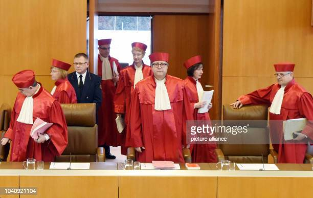 The judges of the second senate of the German Constitutional Court arrive for the announcement of the verdict on the NPD ban proceedings at the...