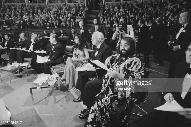 The judges of the the 26th edition of the Miss World pageant, Miss World 1976, at the Royal Albert Hall, London, UK, 19th November 1976: including,...
