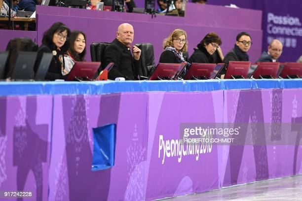 The judges watch a competitor during his routine in the figure skating team event men's single skating free skating during the Pyeongchang 2018...