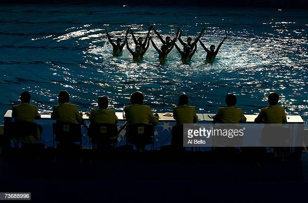 The judges watch as the team from Italy performs in the Free Routine Final at the synchronized swimming event during the XII FINA World Championships...