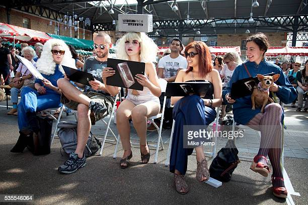 The judging panel at the Paw Pageant dog show at Spitalfields Market London Local people enter their dogs into the Shoreditch Unbound Festival Dog...