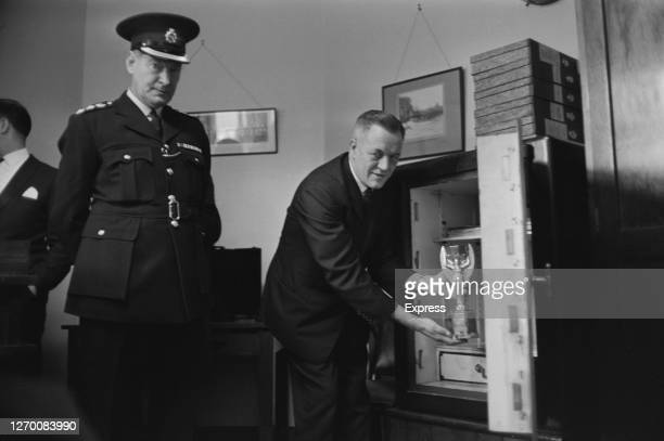The Jules Rimet Trophy for the FIFA World Cup is placed into a safe at Cannon Row Police Station in London, March 1966. It had been stolen on 20th...