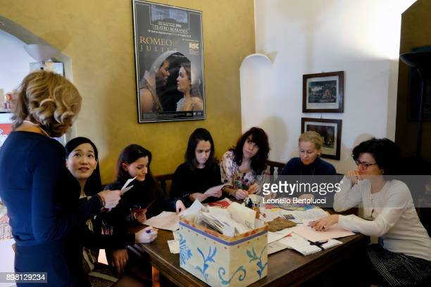 The Juliet Club's team of volunteers responsible for replying to letters received from all over the world pose in Via Cappello 23 which is today...