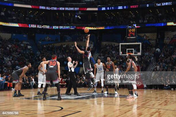 The jump ball between Anthony Davis of the Western Conference AllStar Team and LeBron James of the Eastern Conference AllStar Team during the NBA...