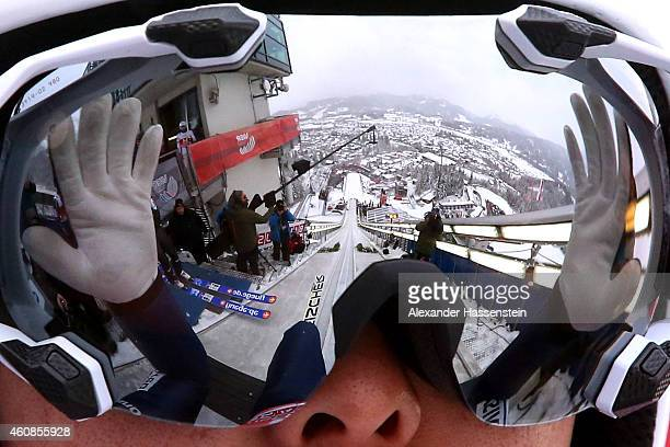 The jump hill is reflected in the ski googles of Junshiro Kobayashi of Japan as he prepares for a jump during day 1 of the Four Hills Tournament Ski...