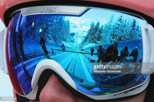 The jumping hill is reflected in the ski googles of Dawid Kubacki of Poland during the qualification round on day 1 of the FIS Ski Flying World...