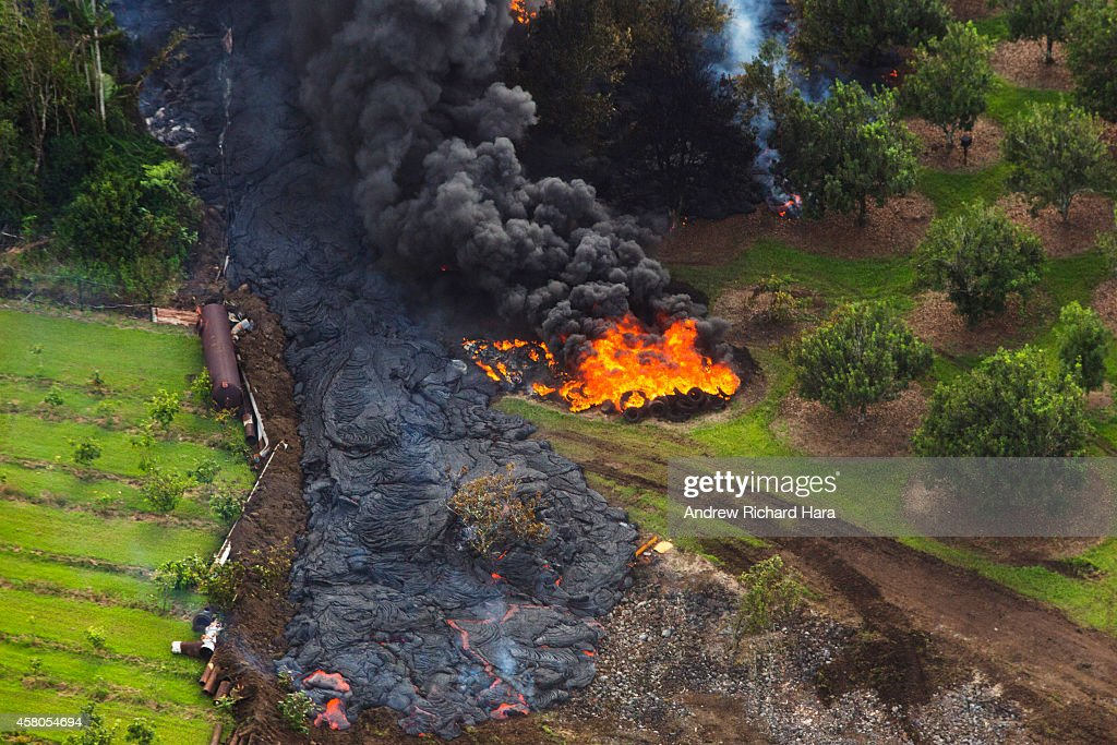 The June 27th lava flow from the Kilauea Volcano moves along he ground October 28, 2014 in Pahoa, Hawaii. Observatory conducted ground and air observations of the lava flow from the Kilauea Volcano and determined that it was 510 meters (560 yards) upslope from Pa-hoa Village Road and the flow width was about 50 meters (55 yards) at the leading edge. Molten rock from the flow is inching its way towards homes in the town of Pahoa on Hawaii's Big Island where close to a thousand people live.