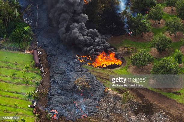 The June 27th lava flow from the Kilauea Volcano moves along he ground October 28 2014 in Pahoa Hawaii Observatory conducted ground and air...