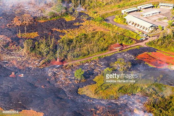 The June 27th lava flow from the Kilauea volcano moves November 10 2014 in Pahoa Hawaii According to reports the lava flow has burned down the first...