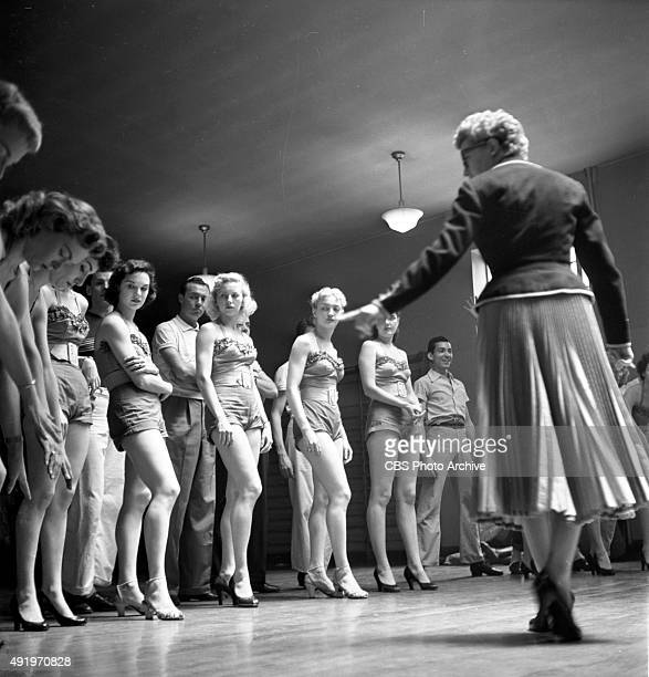 The June Taylor Dancers rehearse for The Jackie Gleason Show New York NY June Taylor is on the right with back to camera in the black short coat and...
