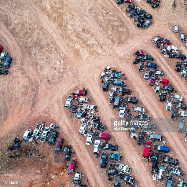 the junkyard - old cars going to be dissassembled and recicled - dismantling stock pictures, royalty-free photos & images