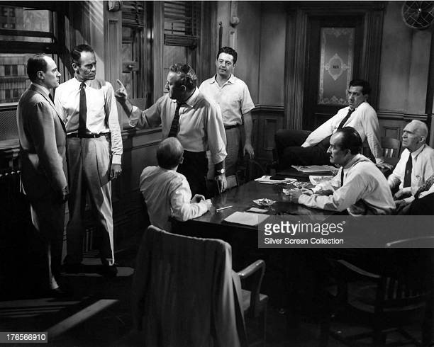 The jurors deliberate their verdict in '12 Angry Men' directed by Sidney Lumet 1957 Left to right E G Marshall Henry Fonda unknown Lee J Cobb Edward...