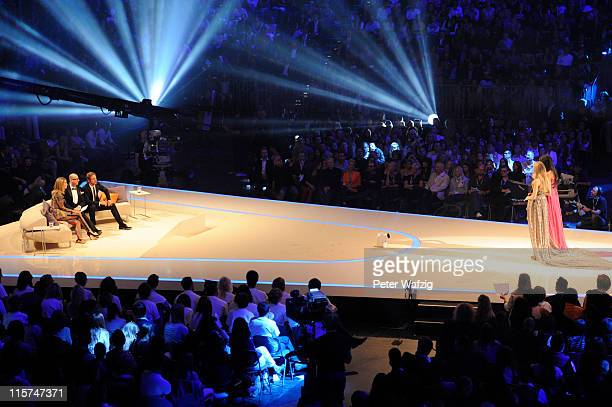 The jury and the finalists during the finalists show of 'Germany's Next Topmodel' at the LanxessArena on June 09 2011 in Cologne Germany