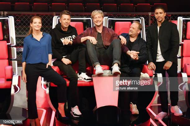 The jury for the 6th season of the music show The Voice of Germany Yvonne Catterfeld Michi Beck Samu Haber Smudo and Andreas Bourani pose during a...