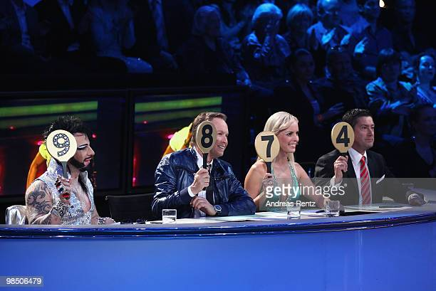 The jury Harald Gloeoeckler Peter Kraus Isabel Edvardsson and Joachim Llambi hold up their scores card during the 'Let's Dance' TV show at Studios...