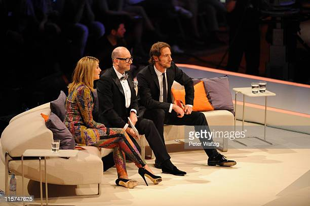 The jury Heidi Klum Thomas Rath and Thomas Hayo look at a performance during the finalists show of 'Germany's Next Topmodel' at the LanxessArena on...