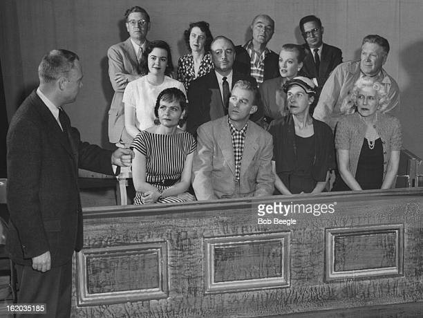 """The jury is attentive as Bob Smedley, prasecuting attorney, asks for a verdict of guilty of murder in the Civic Theater's """"Ladies of the Jury,""""..."""