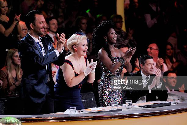 The jury members applaud during the 'Let's Dance' TV Show on March 21 2012 in Cologne Germany
