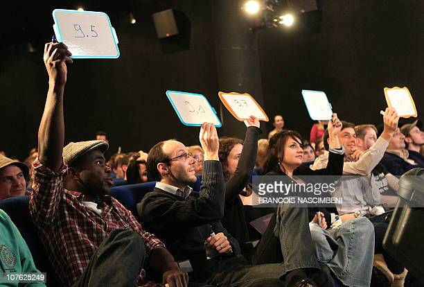 The jury members vote as a slammer performs on stage on December 15 2010 during the first European Cup of Slam an international tournament of poetry...