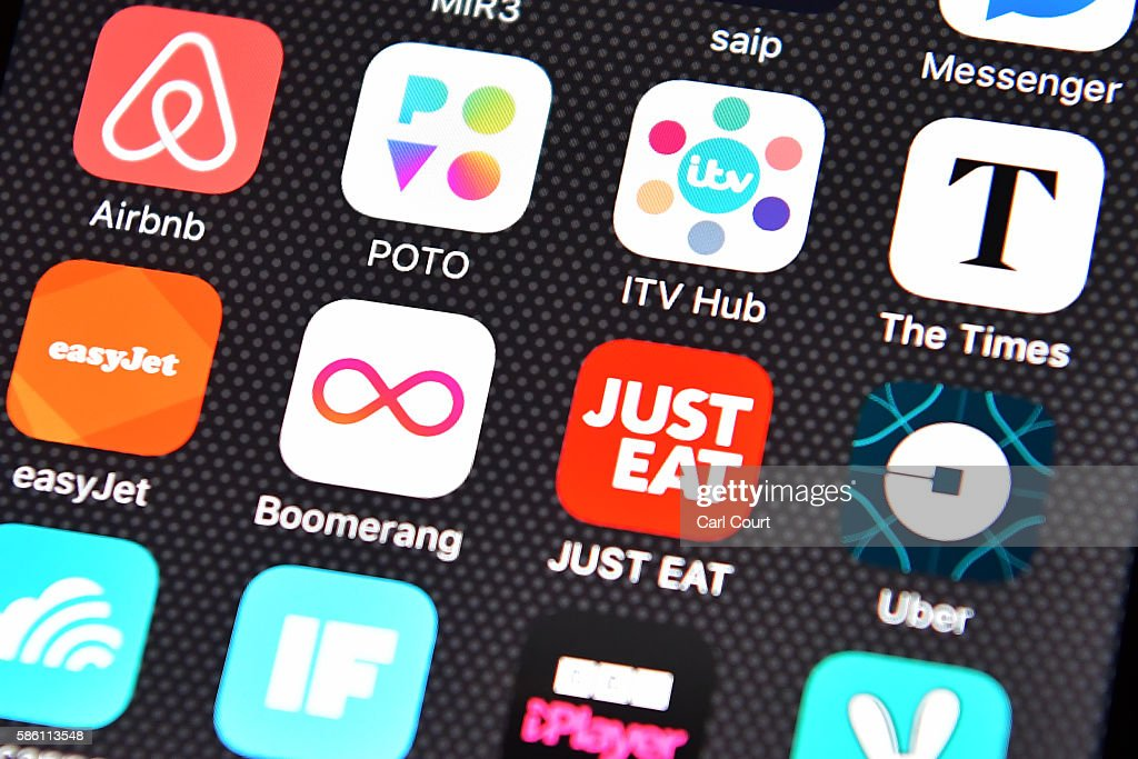 The Just Eat app logo is displayed on an iPhone on August 3, 2016 in London, England.