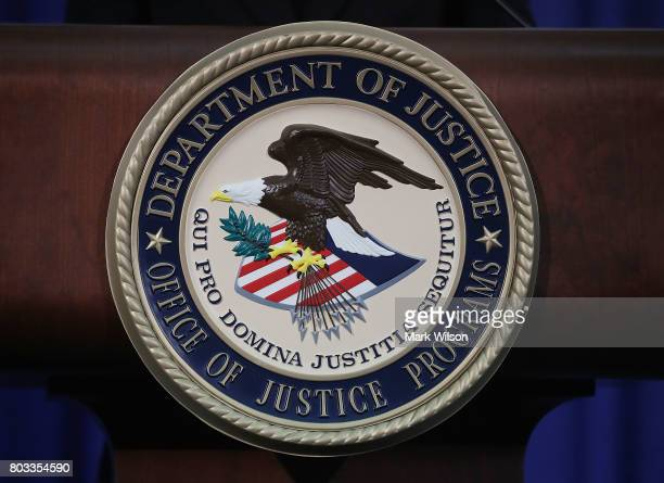 The Justice Department seal is seen on the lectern during a Hate Crimes Subcommittee summit on June 29 2017 in Washington DC The meeting gave...