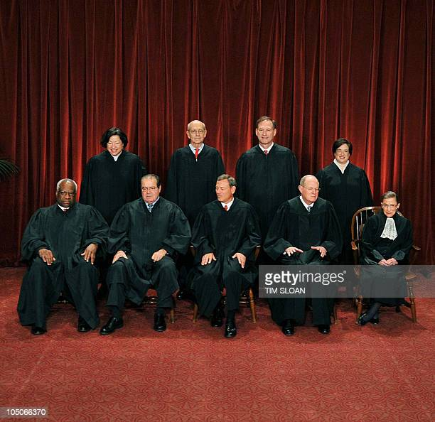 The Justices of the US Supreme Court sit for their official photograph on October 8 2010 at the Supreme Court in Washington DC Front row Associate...