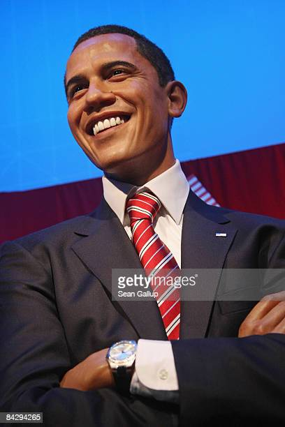 The justunveiled wax figure of US Presidentelect Barack Obama smiles at Madame Tussauds on January 15 2009 in Berlin Germany Obama who is popular in...