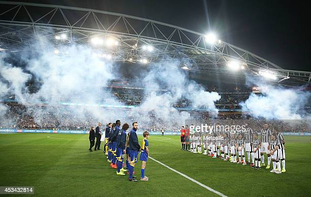 The Juventus and All Stars teams line up before the match between the ALeague All Stars and Juventus at ANZ Stadium on August 10 2014 in Sydney...