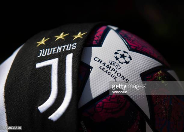 The Juventus club crest on the first team home shirt displayed with the official Adidas UEFA Champions League match ball on May 6 2020 in Manchester...