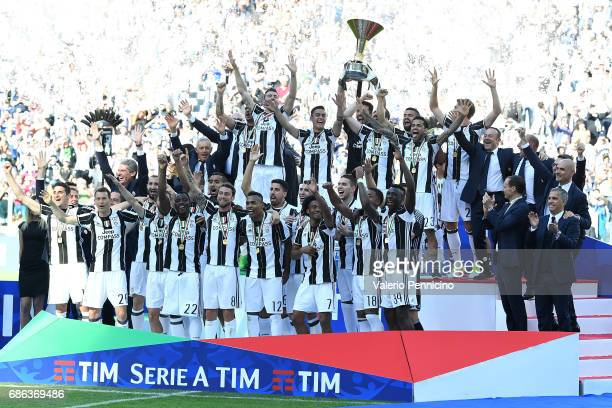 The Juventus FC players celebrate with the Serie A trophy after beating FC Crotone 30 to win the Serie A Championships at the end of the Serie A...