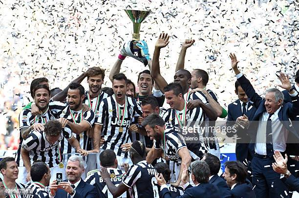 The Juventus FC players celebrate with the Serie A trophy at the end of the Serie A match between Juventus and Cagliari Calcio at Juventus Arena on...