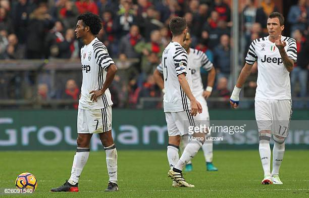 The Juventus FC players show their dejection during the Serie A match between Genoa CFC and Juventus FC at Stadio Luigi Ferraris on November 27 2016...