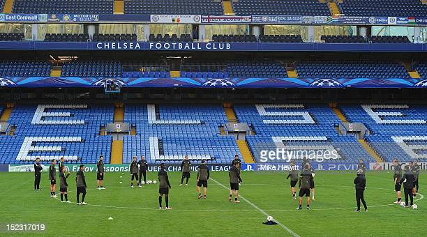 The Juventus squad warms up during a Juventus Training Session Press Conference ahead of the Uefa Champions League Group E match between Chelsea and...