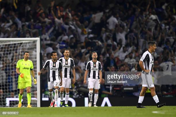 The Juventus team are dejected after Real Madrid score during the UEFA Champions League Final between Juventus and Real Madrid at National Stadium of...