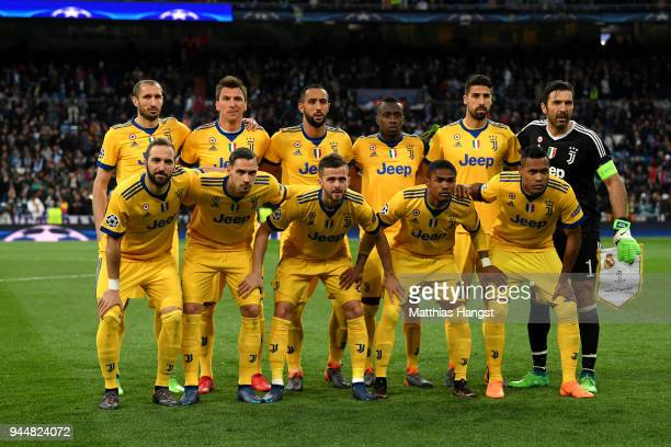 The Juventus team line up prior to the UEFA Champions League Quarter Final Second Leg match between Real Madrid and Juventus at Estadio Santiago...