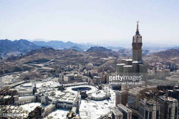 the kaaba also known as masjid ul haram, the holiest place on earth for the muslims - tower stock pictures, royalty-free photos & images