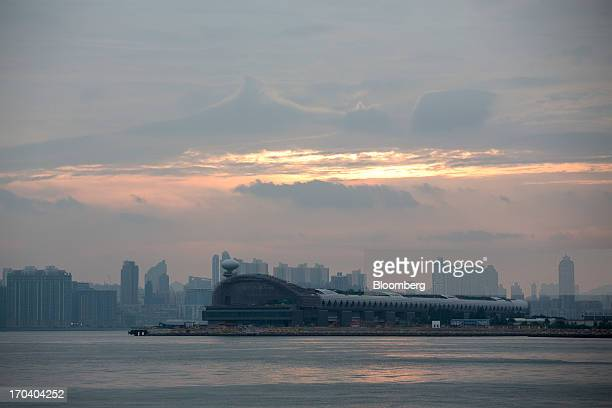 The Kai Tak Cruise Terminal sits on the site of the city's former Kai Tak Airport at dusk in Hong Kong China on Wednesday June 12 2013 Hong Kong has...