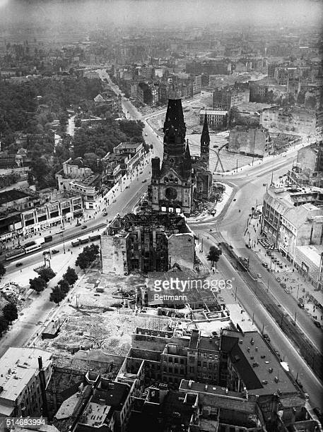 The Kaiser Wilhelm Memorial Church suffering from extensive bomb damage sits amidst rubble in Berlin Germany
