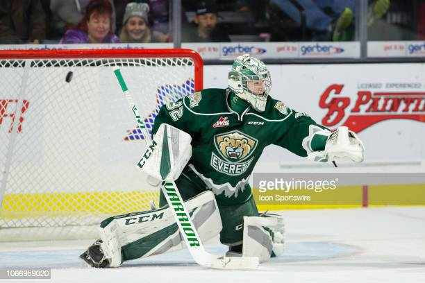 The Kamloops Blazers get a puck past the glove of Everett Silvertips goaltender Dustin Wolf in the first period during a game between the Everett...