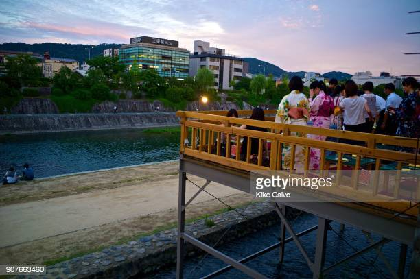 The Kamo River flows through the centre of Kyoto creating a unique riverside for leisure and daily life