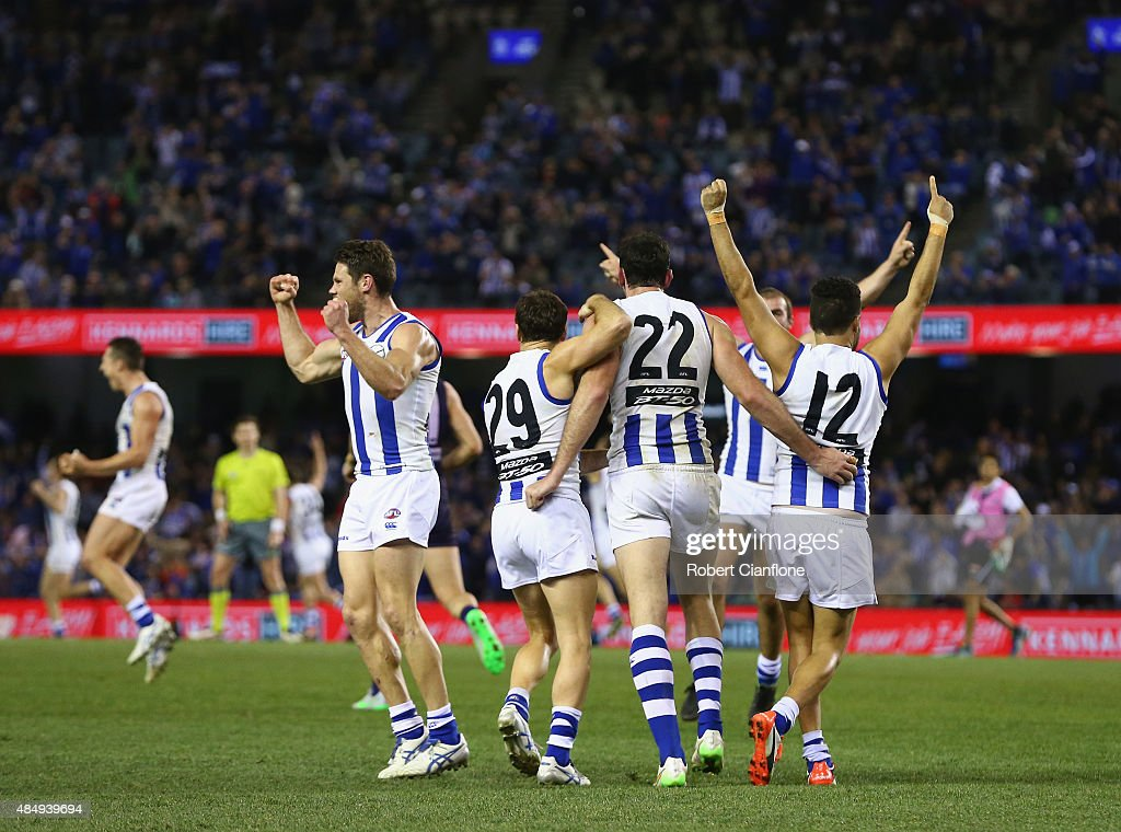 The Kanagroos celebrate after they defeated the Dockers during the round 21 AFL match between the North Melbourne Kangaroos and the Fremantle Dockers at Etihad Stadium on August 23, 2015 in Melbourne, Australia.