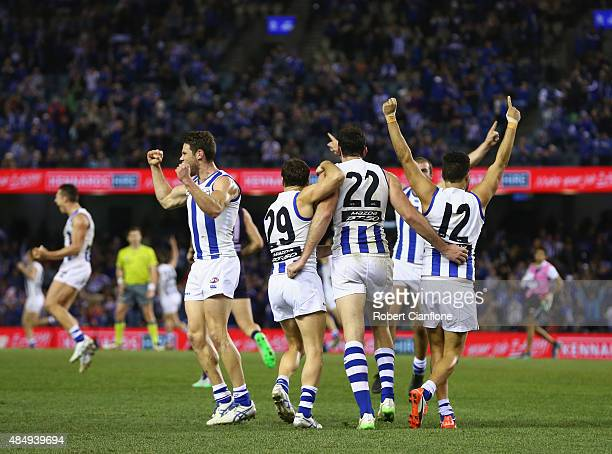The Kanagroos celebrate after they defeated the Dockers during the round 21 AFL match between the North Melbourne Kangaroos and the Fremantle Dockers...
