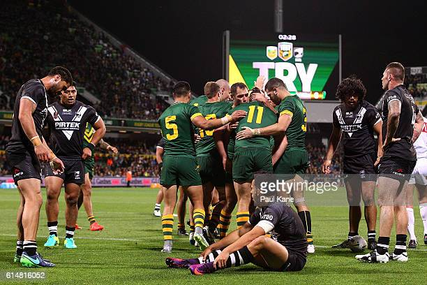 The Kangaroos celebrate a try as the Kiwi's look on during the International Rugby League Test match between the Australian Kangaroos and the New...