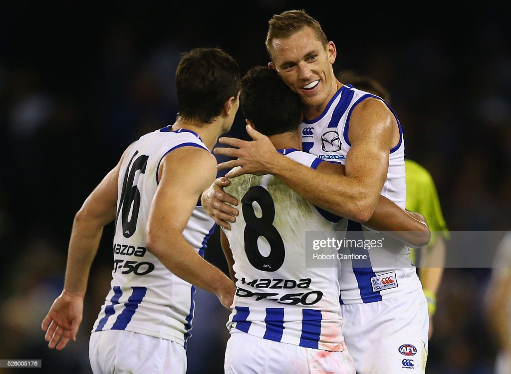 The Kangaroos celebrate after they defeated the Bulldogs during the round six AFL match between the North Melbourne Kangaroos and the Western Bulldogs at Etihad Stadium on April 29, 2016 in Melbourne, Australia.