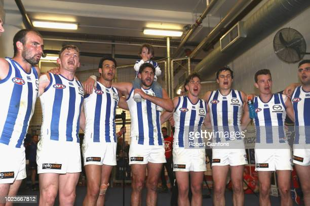 The Kangaroos celebrate after they defeated the Saints during the round 23 AFL match between the St Kilda Saints and the North Melbourne Kangaroos at...