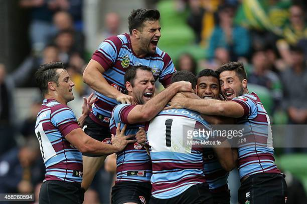 The Kangaroos celebrate the try scored by Greg Inglis of Australia during the Four Nations match between the Australian Kangaroos and England at AAMI...