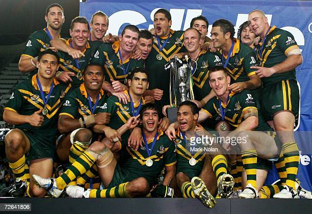 The Kangaroos celebrate with the tri-nations trophy after winning the 2006 Tri-Nations final match between the Australian Kangaroos and the New...
