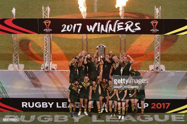 The Kangaroos celebrate with the trophy after winning the 2017 Rugby League World Cup Final between the Australian Kangaroos and England at Suncorp...
