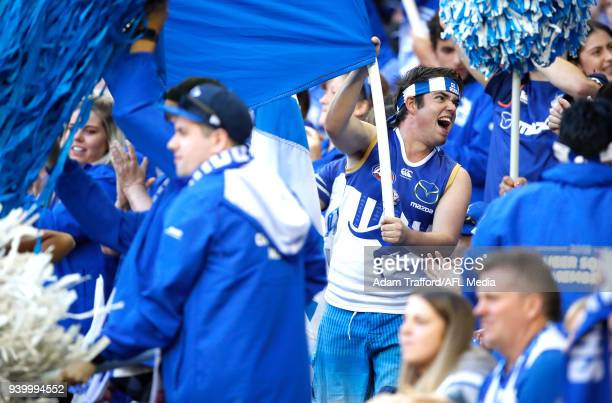 The Kangaroos cheer squad celebrate a goal during the 2018 AFL round 02 Good Friday Kick for the Kids match between the North Melbourne Kangaroos and...