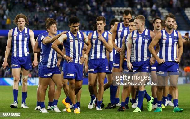 The Kangaroos look dejected after a loss during the 2017 AFL round 04 match between the North Melbourne Kangaroos and the Western Bulldogs at Etihad...